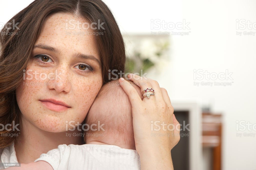 Serene mother holding her baby stock photo
