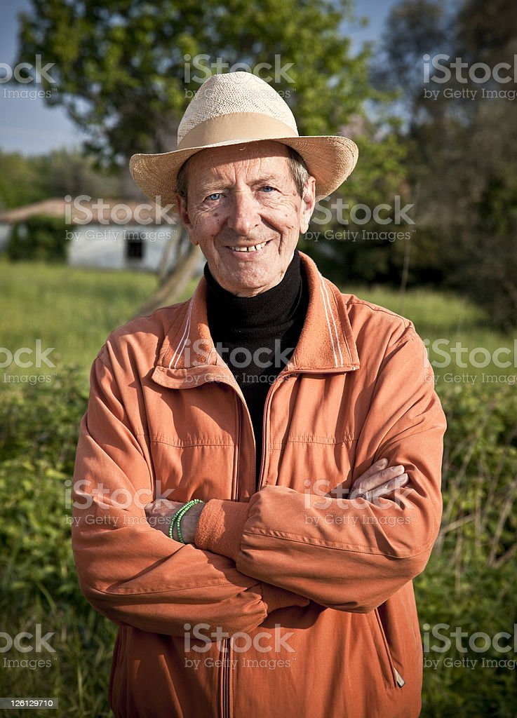 Serene Old Farmer Posing in the fields royalty-free stock photo