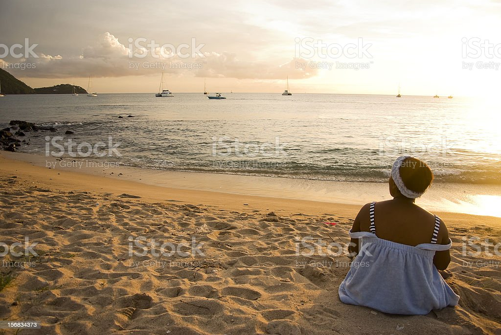 serene peaceful woman sitting on beach sand at dawn - Royalty-free Adult Stock Photo