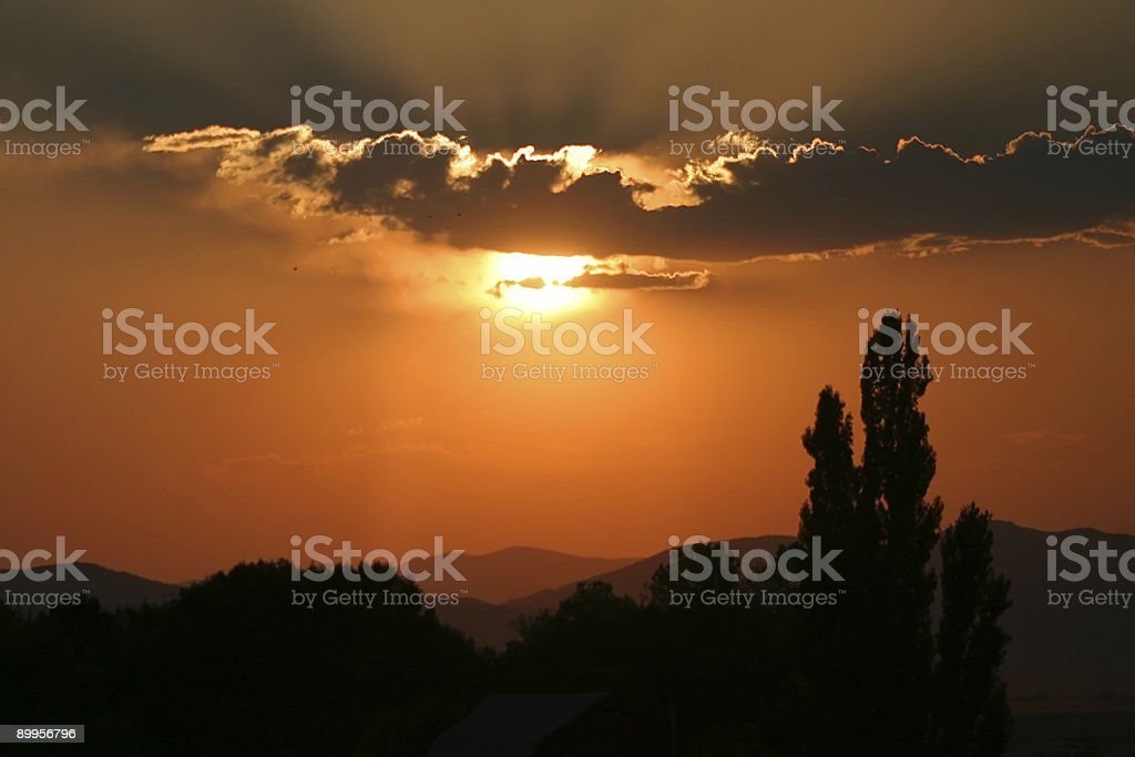 Serene Rural Sunset with Coudscape and Poplars in Silhouette royalty-free stock photo
