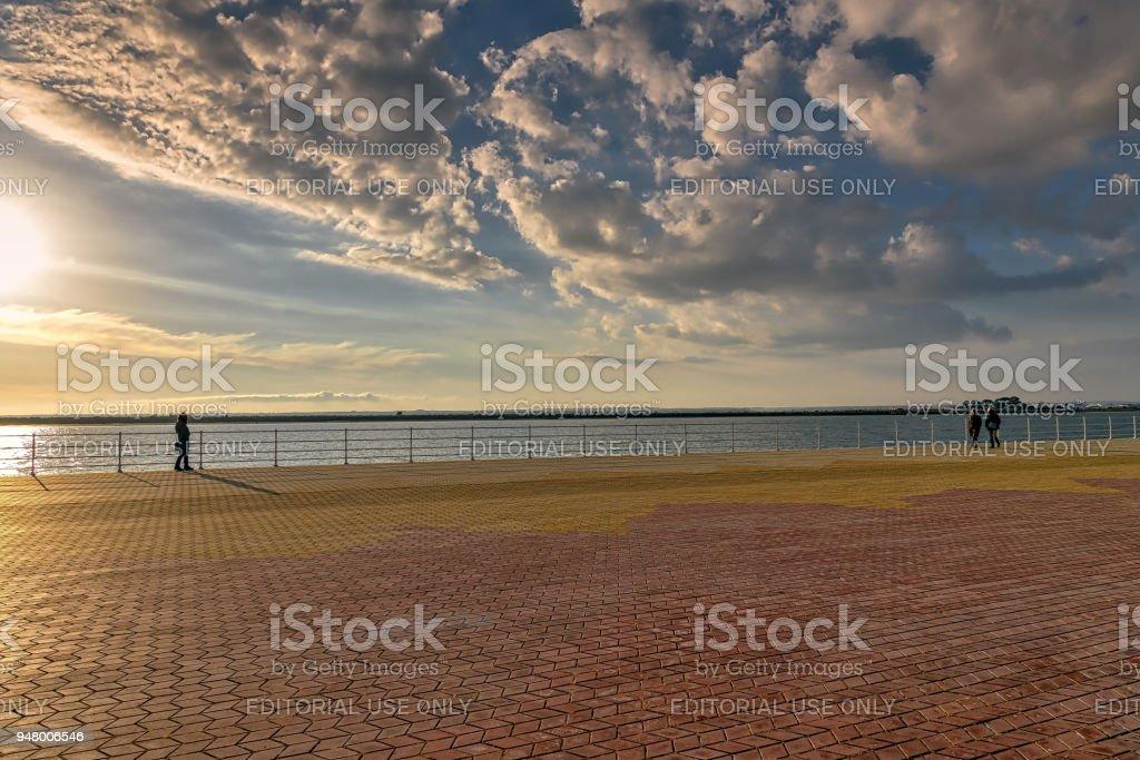 Serene sunset on the boardwalk of river Odiel in Huelva, Spain. stock photo