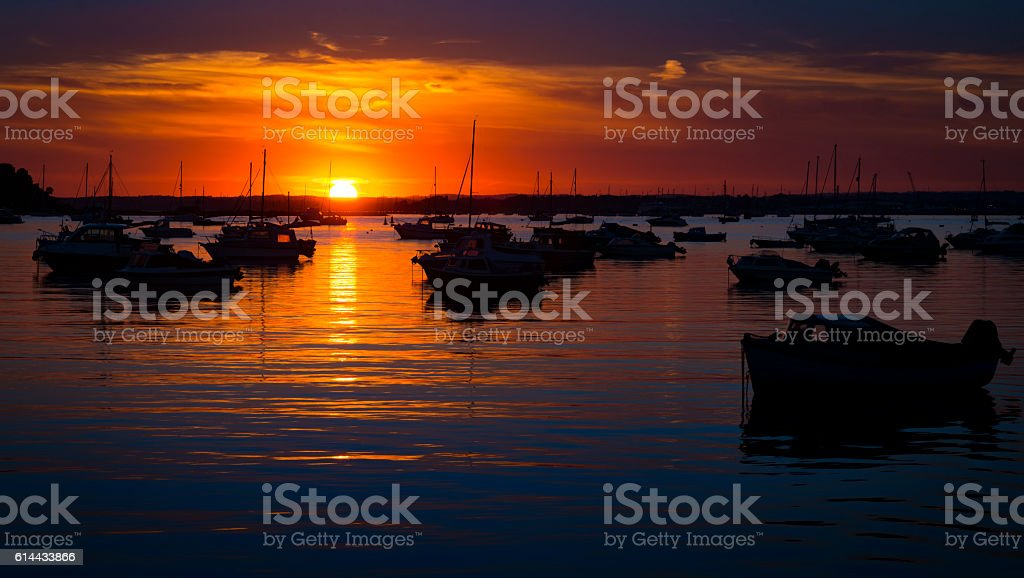 Serene sunset over boats at Sandbanks, Poole, Dorset near Bournemouth stock photo