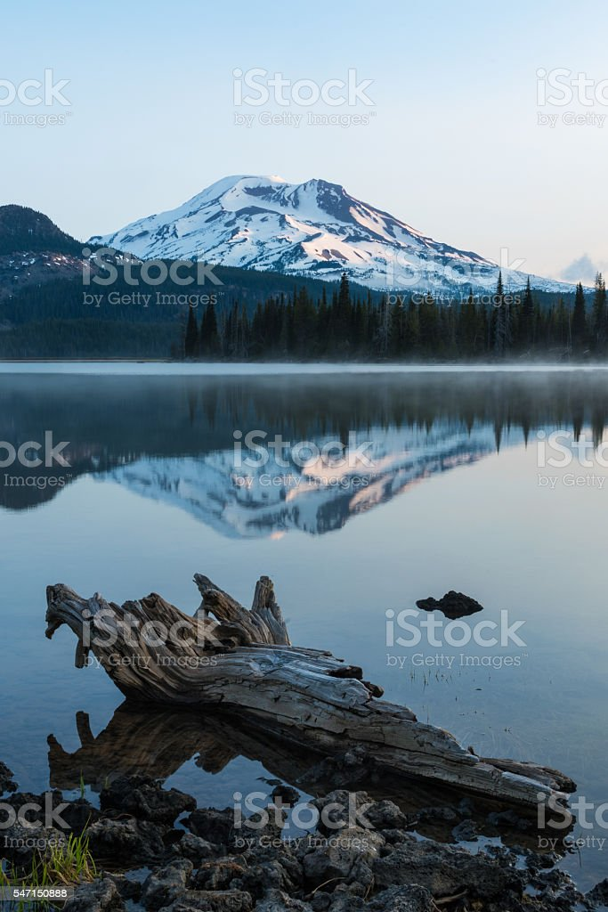 Serene view of mountain reflected in lake stock photo
