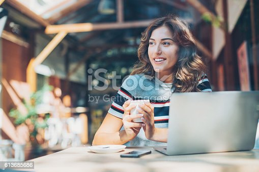 istock Serene woman in cafe 613685686