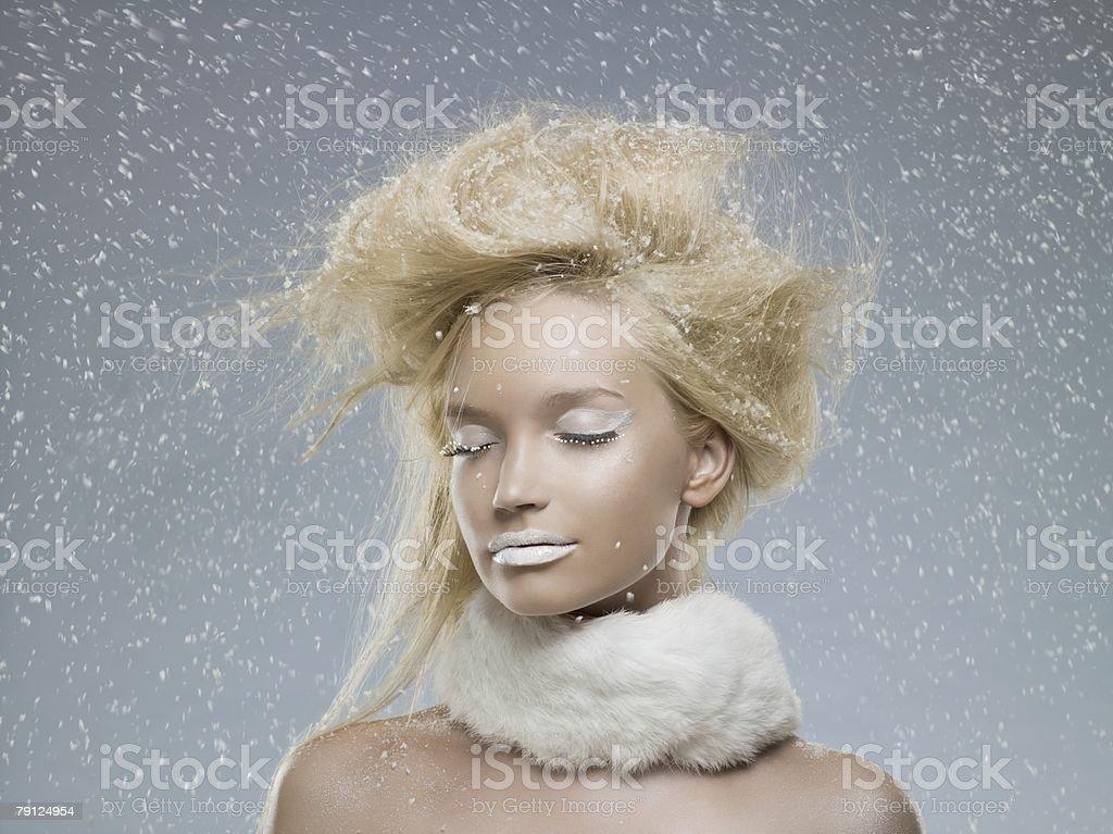 Serene woman in the snow 免版稅 stock photo