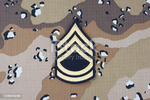 istock US ARMY Sergeant First Class rank patch on desert camouflage uniform background 1206926283