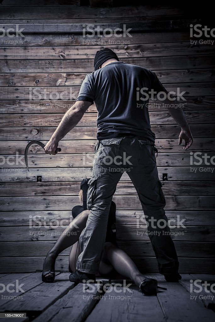 Serial killer and his new victim royalty-free stock photo
