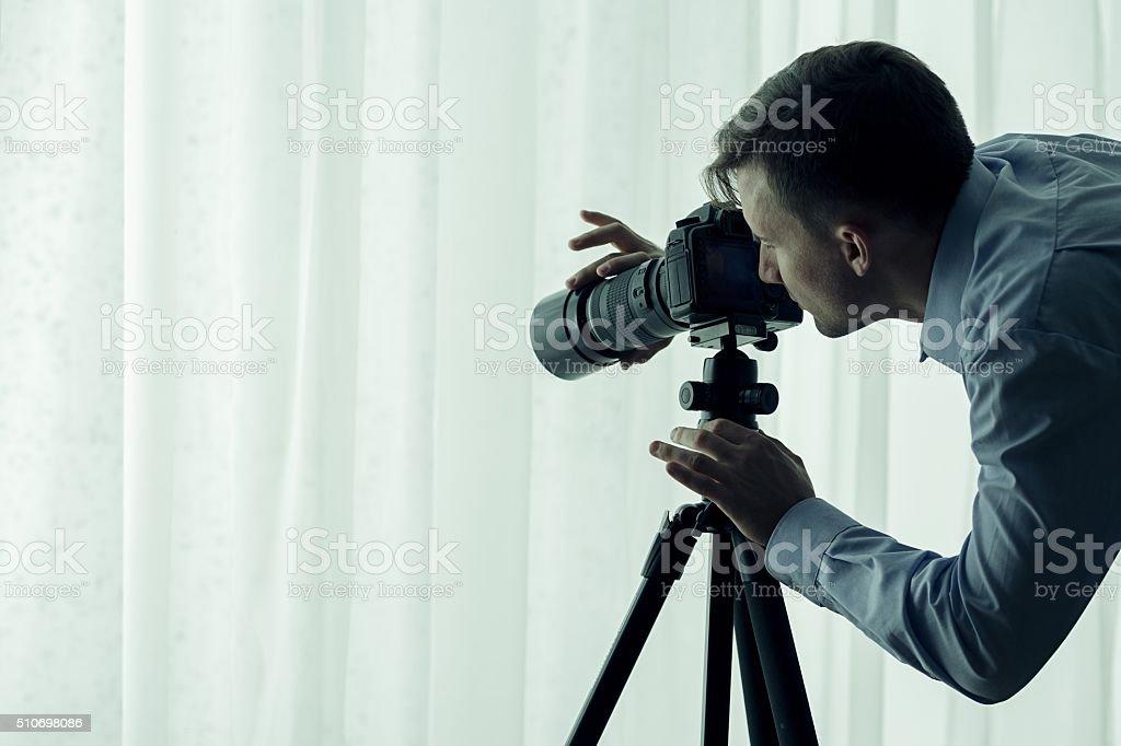 Serial killer watching victim stock photo