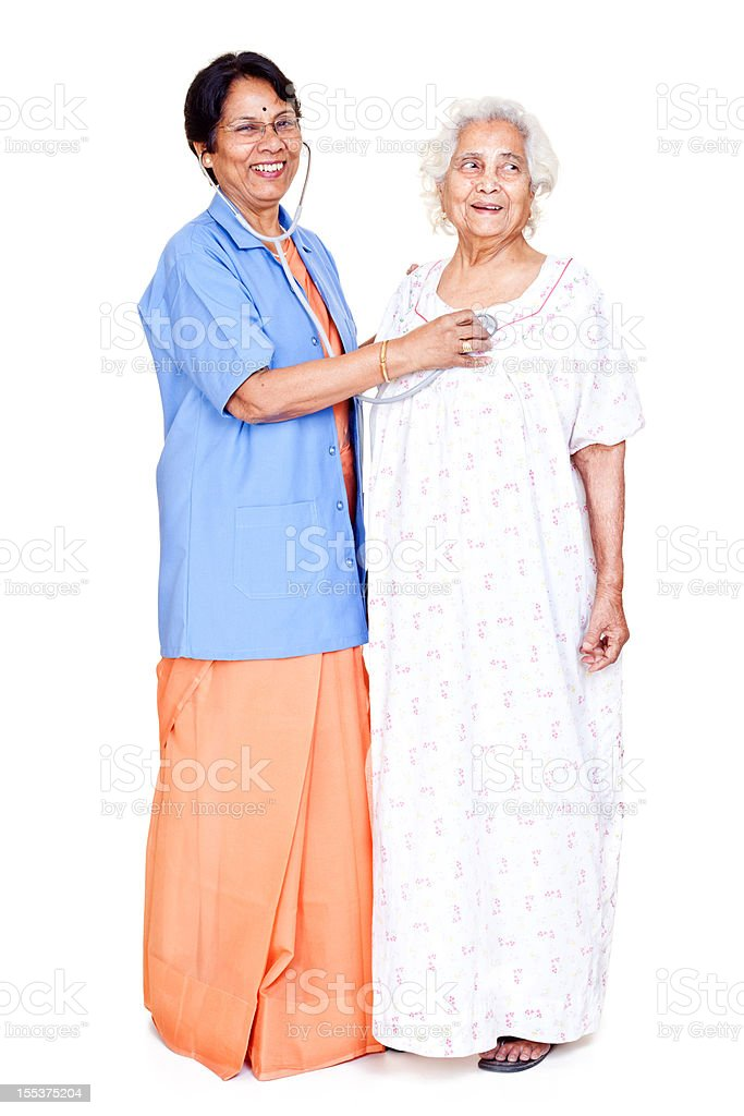Series... Cheerful Senior Indian Female Doctor examining old aged patient royalty-free stock photo