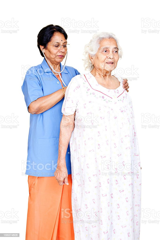Series - Cheerful Senior Indian Female Doctor examining old patient royalty-free stock photo
