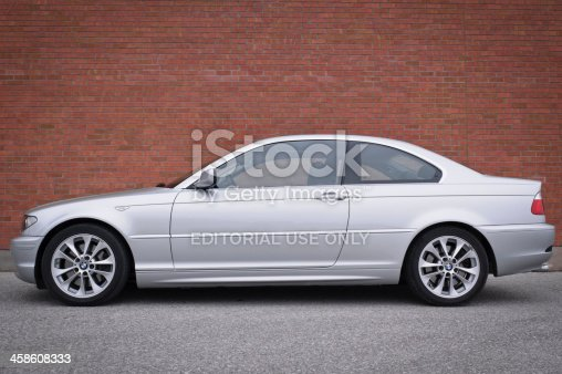 Toronto, ON, Canada - November 12, 2006: BMW 3 Series (E46) coupe in Titanium Silver Metallic parked in front of a brick wall.