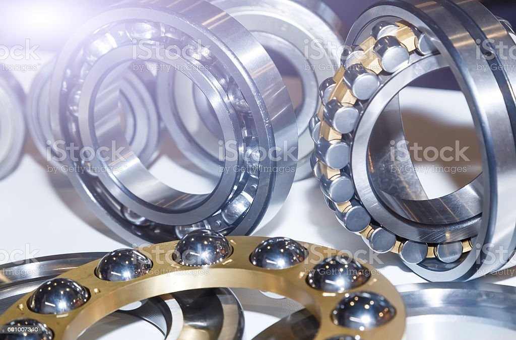 Series of ball bearings background with light effect close-up stock photo
