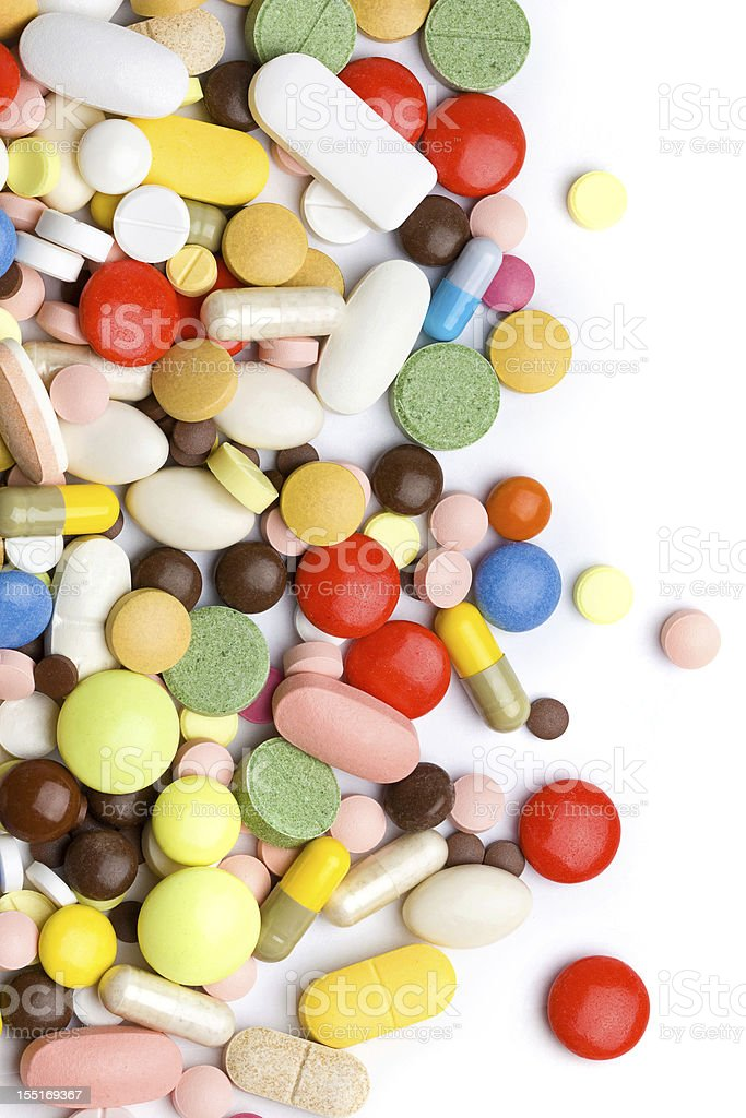 A series of colored pills and tablets stock photo
