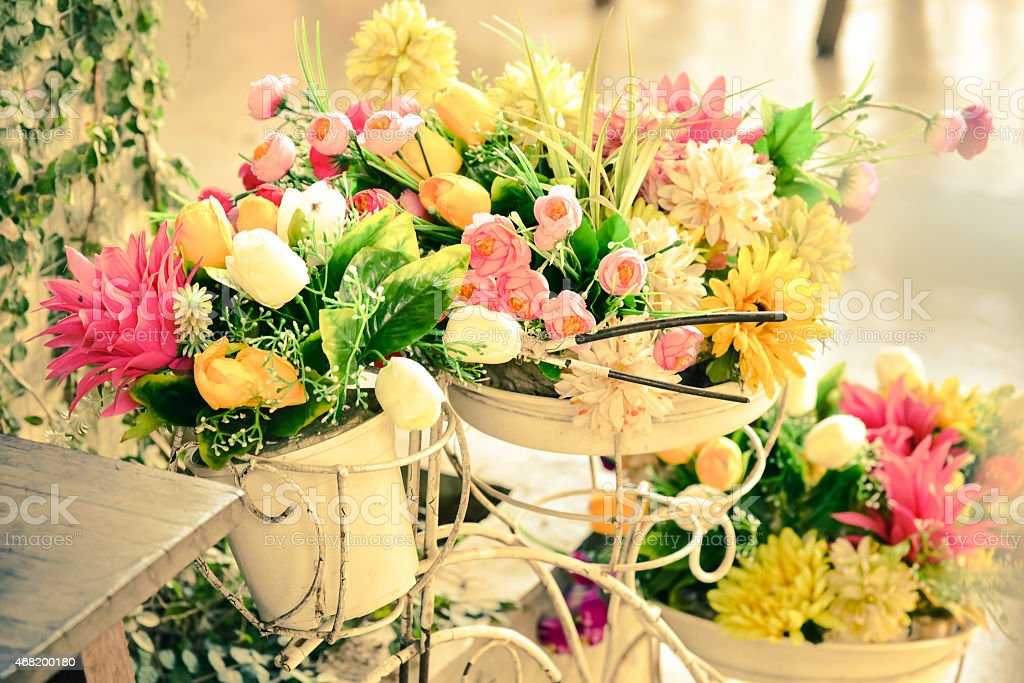 Series of floral arranges with yellow and pink flowers stock photo