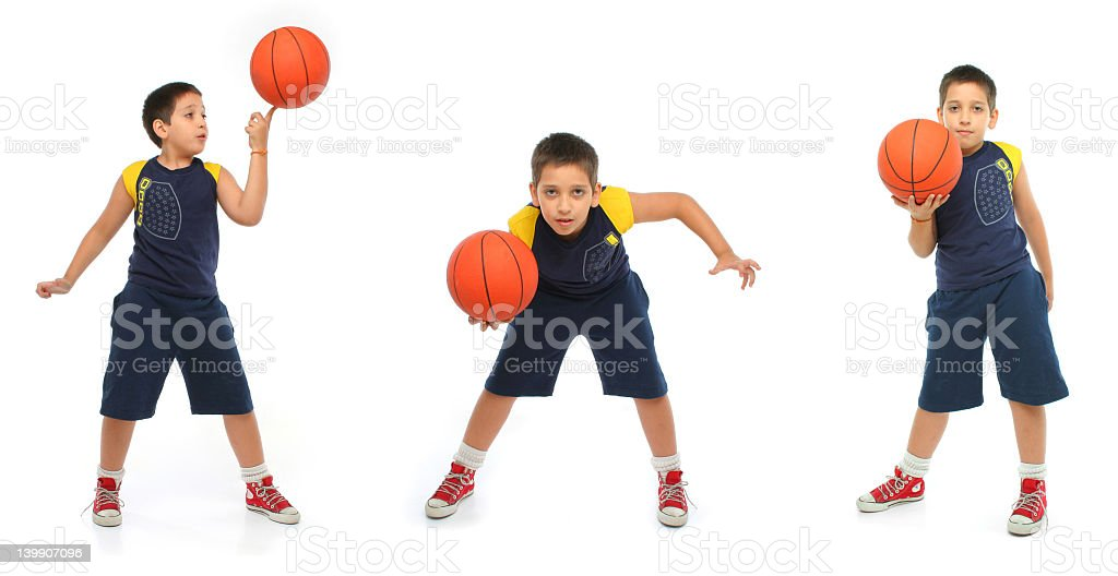 Series of poses by male child holding a basketball stock photo