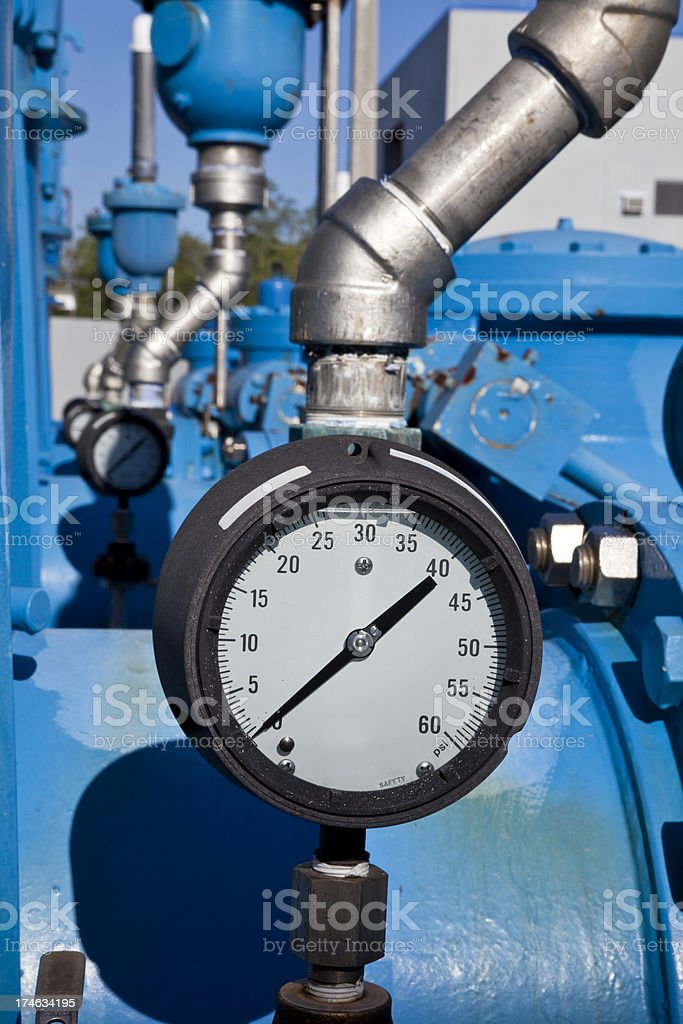 Series of Pressure Gauges on Huge Blue Pipes royalty-free stock photo