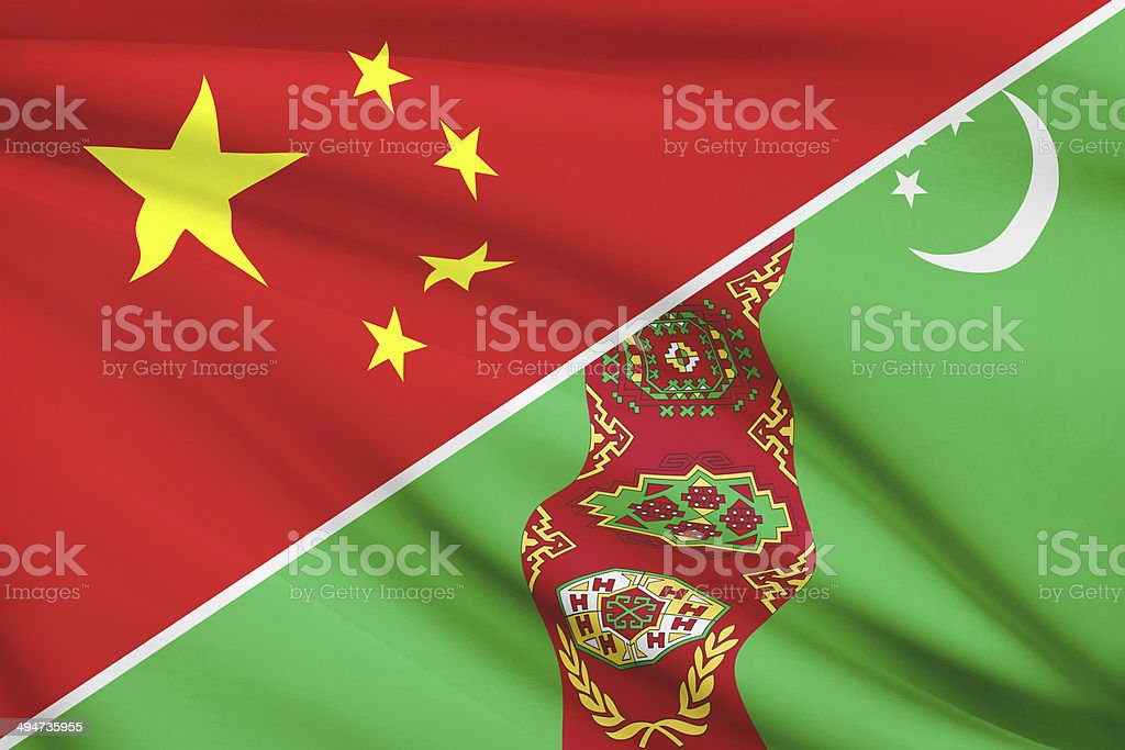 Series of ruffled flags. China and Turkmenistan. stock photo