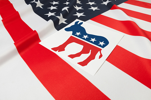 Ruffled flag series - flag of United States of America with democratic party symbol over it