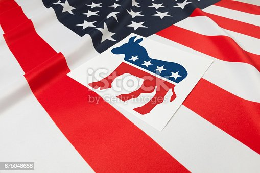 1157022917 istock photo Series of USA ruffled flags with democratic party symbol over it 675048688