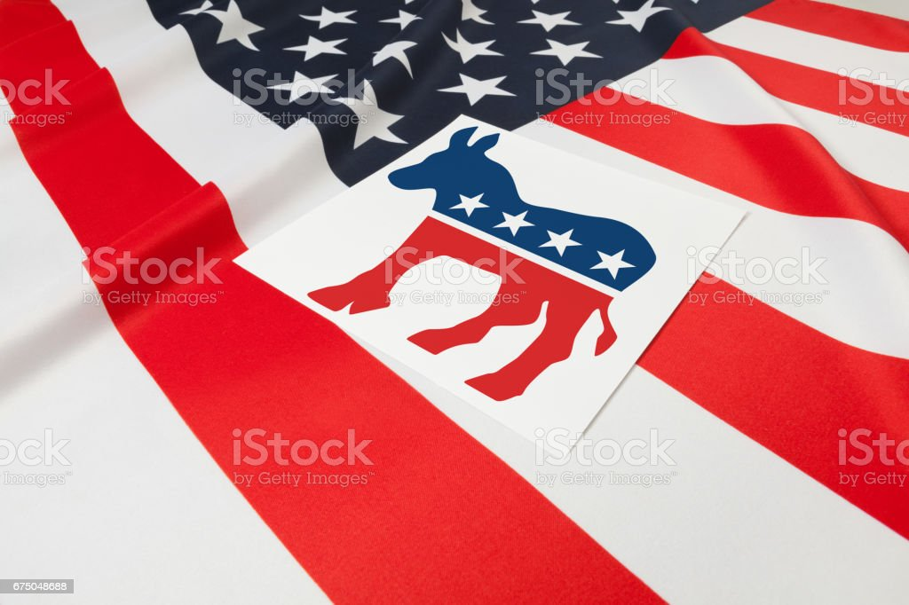 Series of USA ruffled flags with democratic party symbol over it stock photo