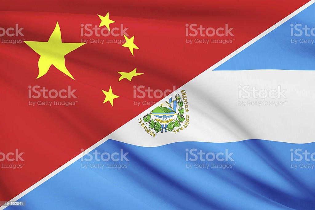 Series - ruffled flags. China and Republic of El Salvador. stock photo