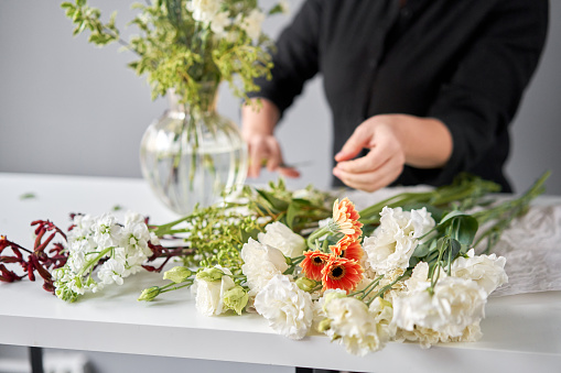 Series, step by step installation of flowers in a vase. Flowers bunch, set for home. Fresh cut flowers for decoration home. European floral shop. Beautiful bouquet of mixed flowers . Delivery fresh cut flower