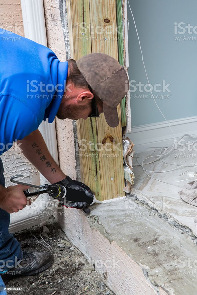 Series:Caulking cement footing for hurricane impact glass door stock photo