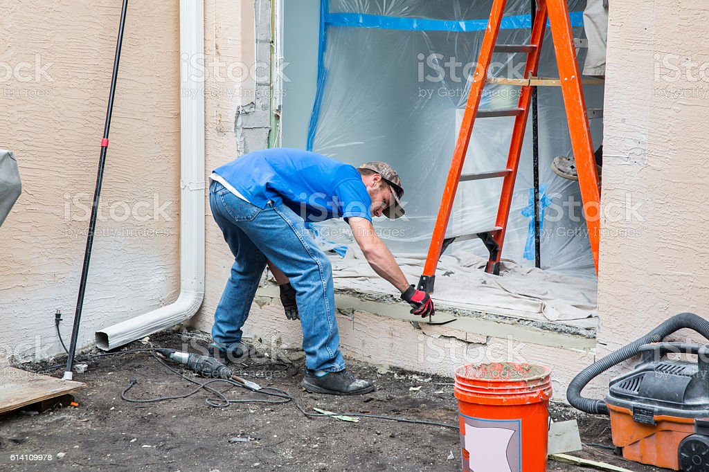 Series:Constructing  footing for installation of impact resistant glass doors. stock photo