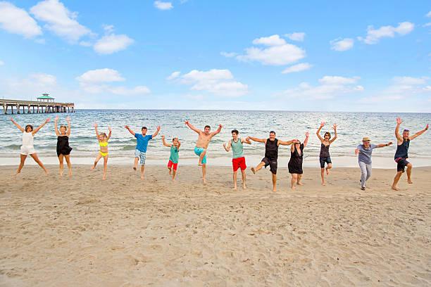 Series:Family having fun on reunion vacation at public beach stock photo