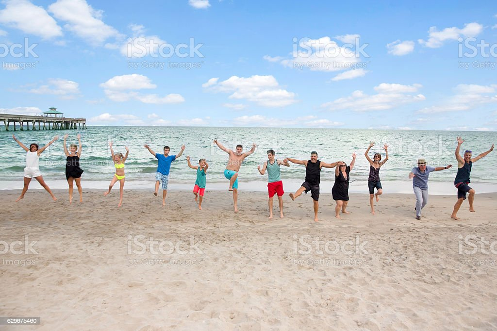 Series:Family having fun on reunion vacation at public beach stock photo