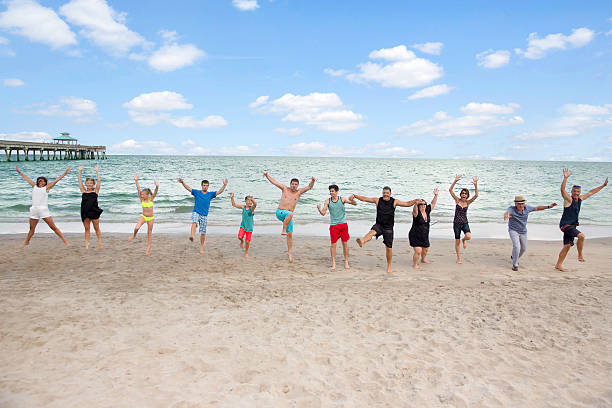 Series:Family having fun on reunion vacation at public beach ストックフォト