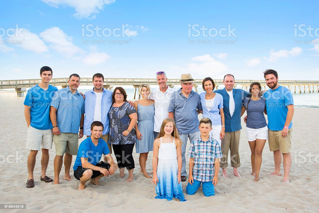 Series:Family having reunion vacation at public beach - foto de acervo