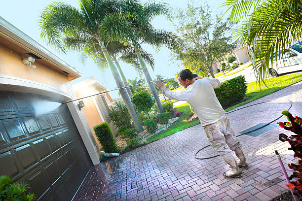 series:hispanic male painter power washing an upscale home - high pressure cleaning stock photos and pictures