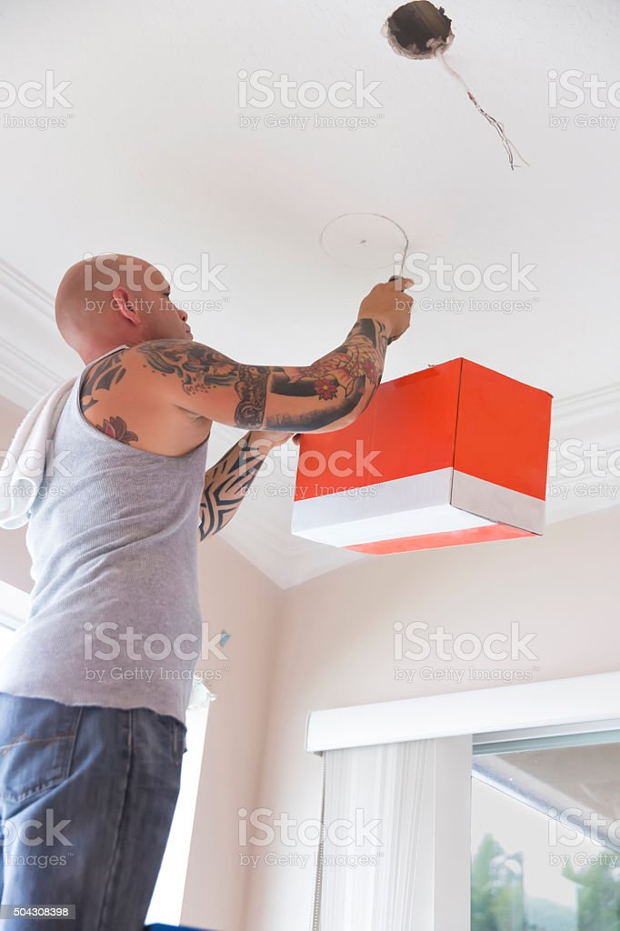 Superb Seriestattooed Electrician Installing Recessed Lighting In Home Wiring 101 Akebretraxxcnl