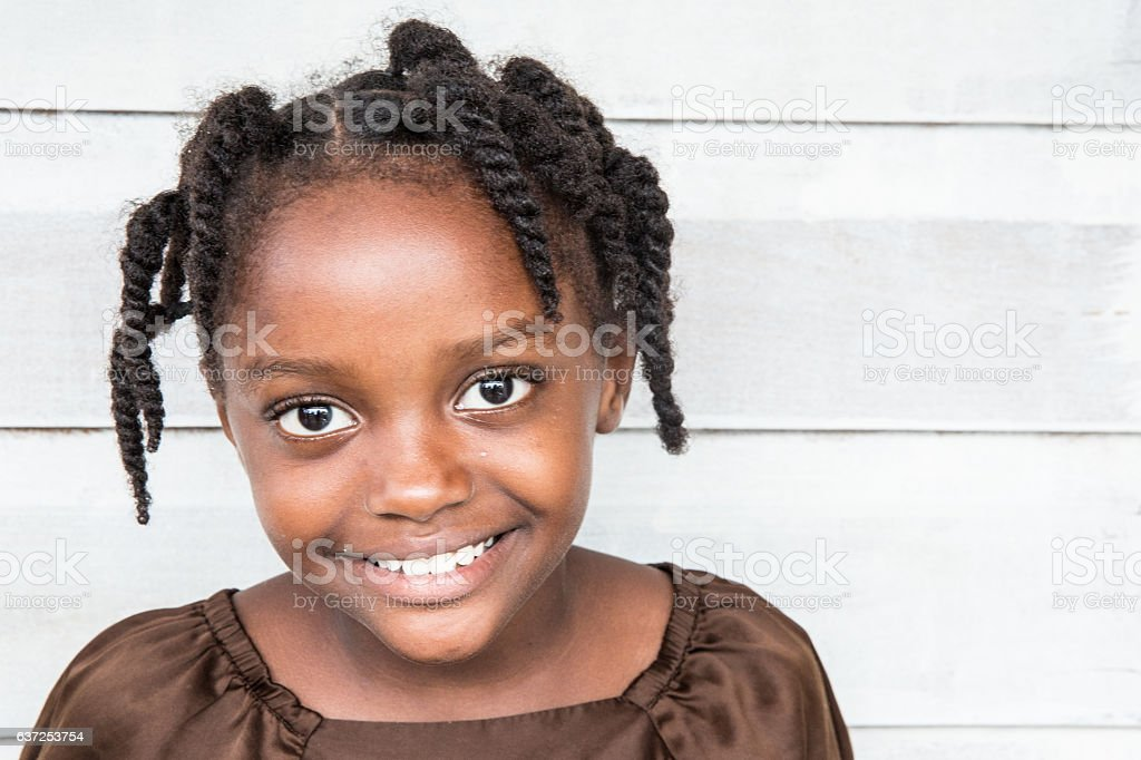 Series:Young Honduran girl with braided hair stock photo