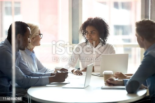 istock Serious african american female leader talking at diverse group meeting 1146468265