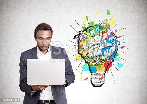 istock Serious African American man laptop, business idea 895493084