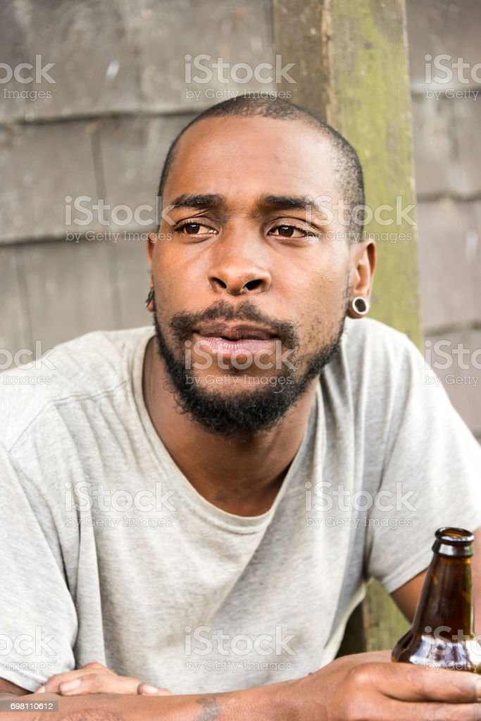 serious afro caribbean young man stock photo
