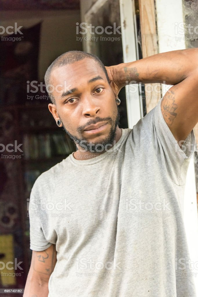 serious afro caribbean young manman stock photo