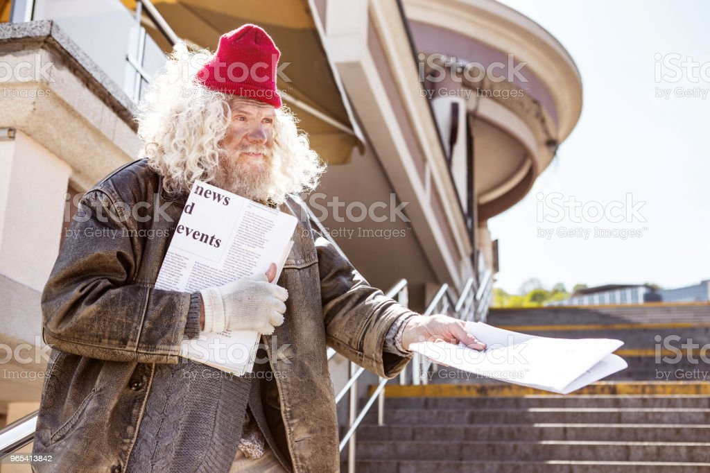 Serious aged man earning money royalty-free stock photo