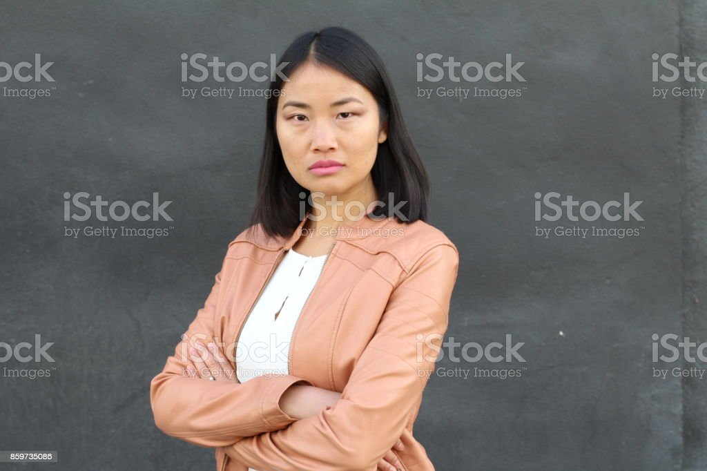 Serious Asian elegant woman close up stock photo