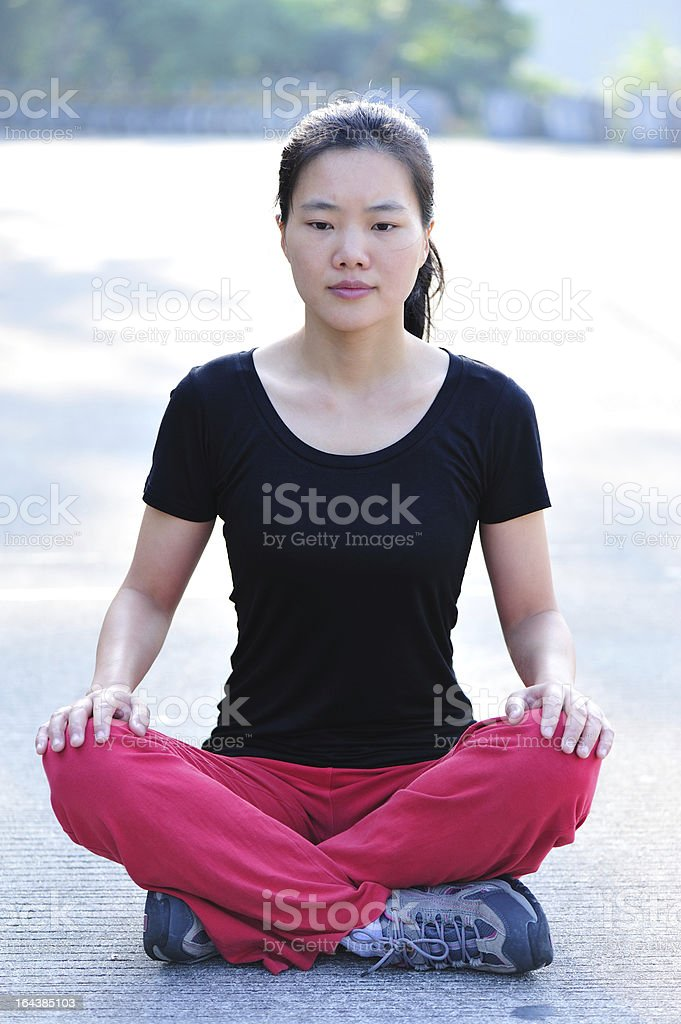 serious asian woman sit crossed legs royalty-free stock photo