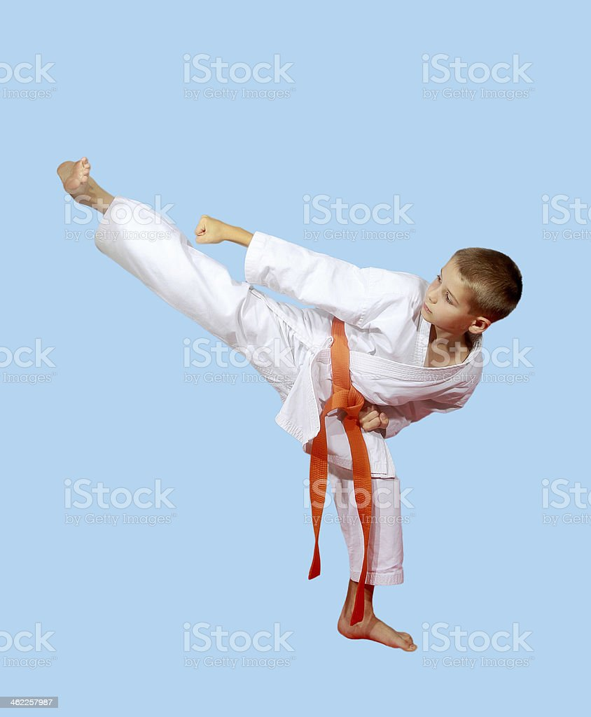 Serious Athlete Beat Blow Foot On A Light Background