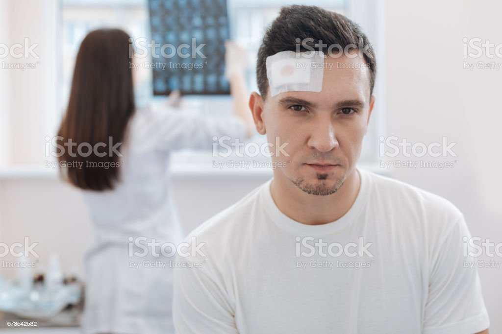 Serious attractive man looking at you stock photo