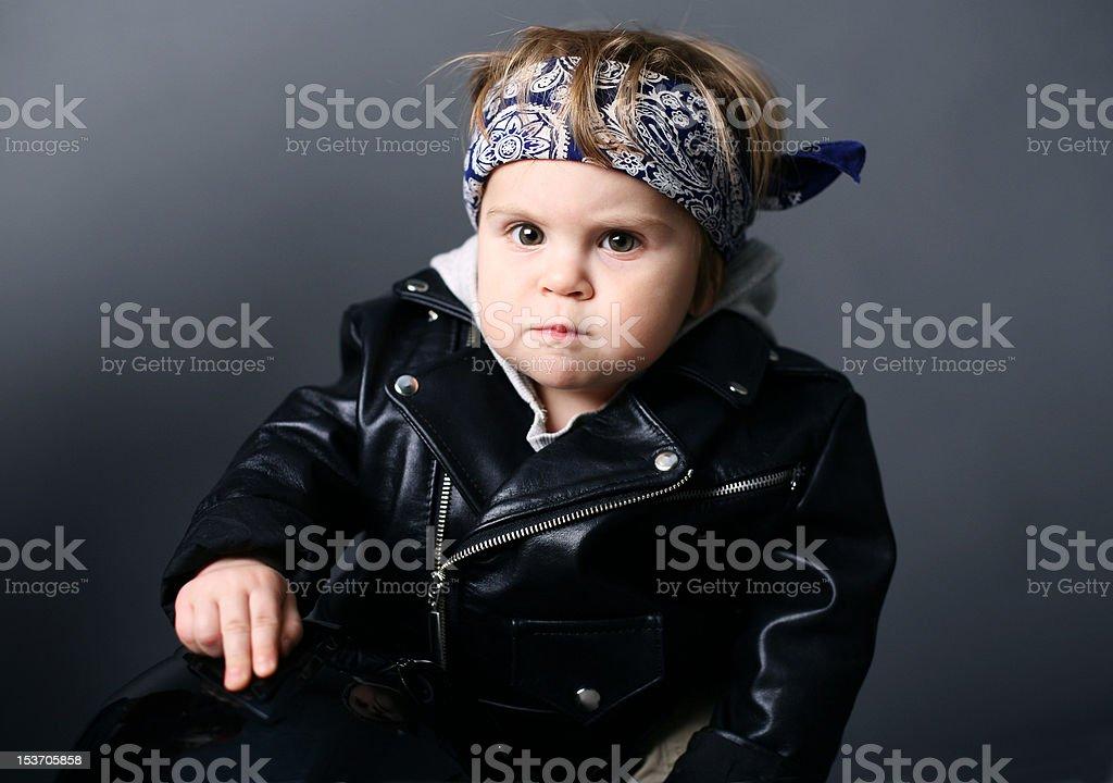 Graves bebé en chaqueta de cuero - foto de stock
