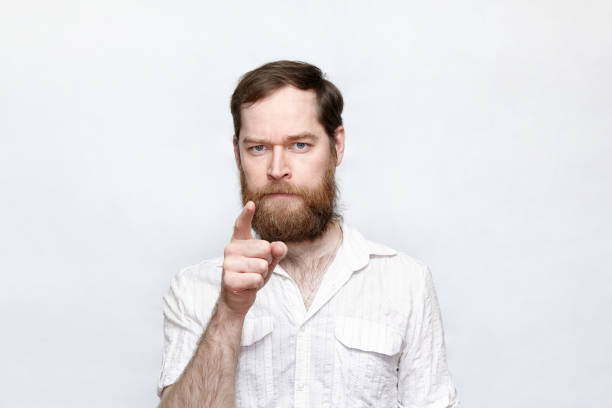 Serious bearded man pointing at camera stock photo