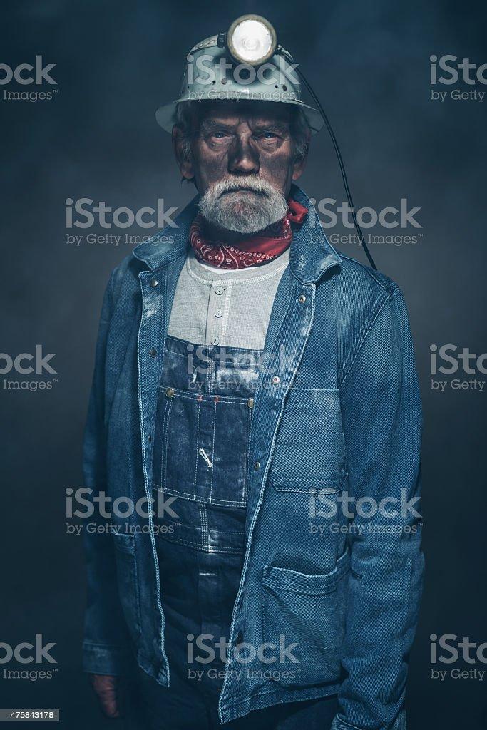 Serious Bearded Senior Male Miner in Denim Jacket stock photo