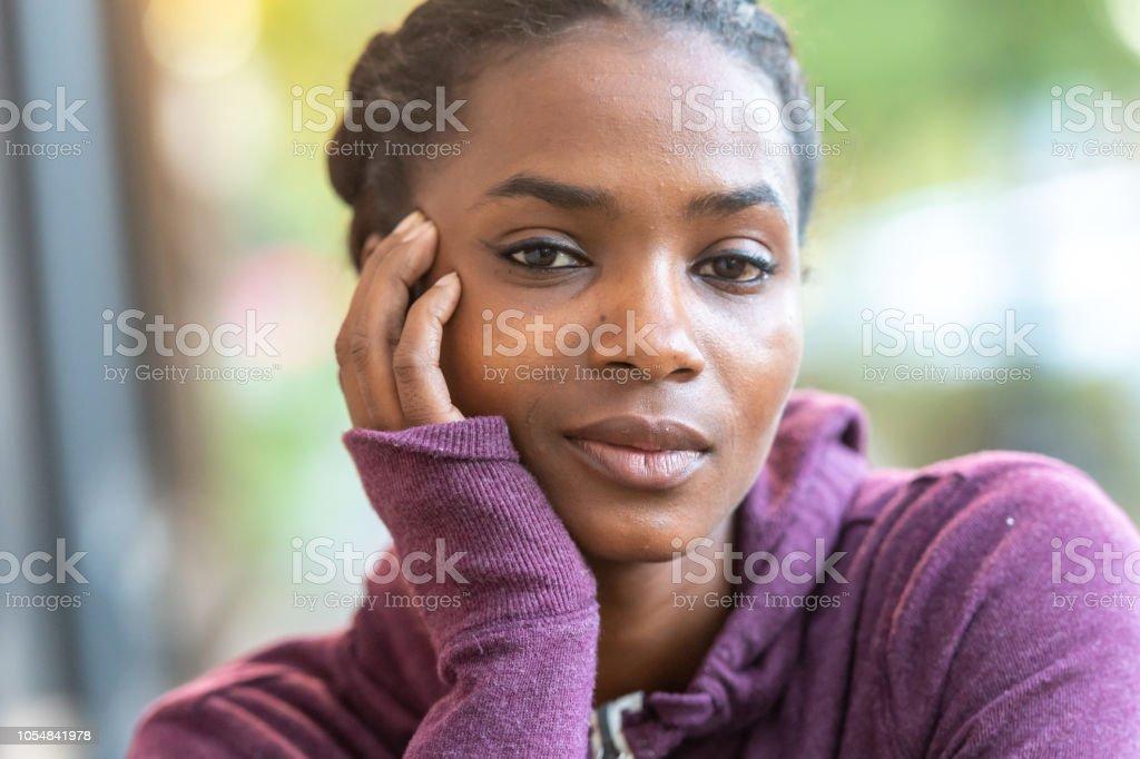 Serious beautiful young black woman stock photo