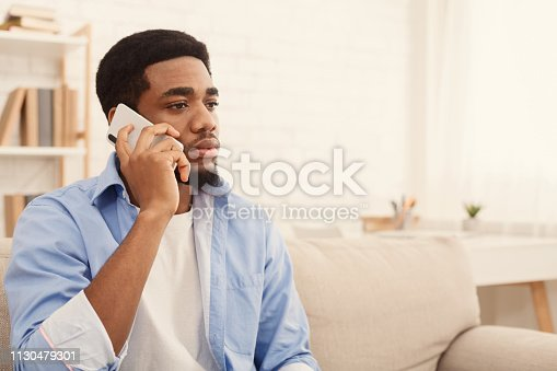istock Serious black male company owner has phone conversation 1130479301