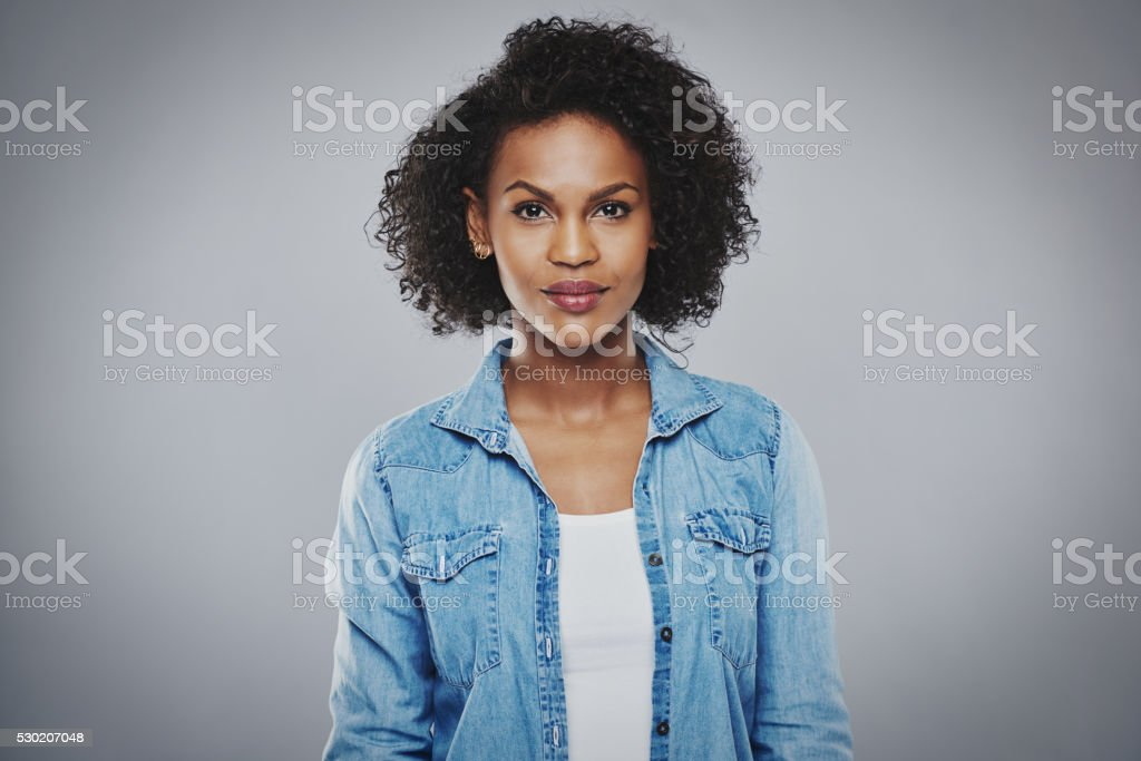 Serious black woman with blue jean shirt stock photo